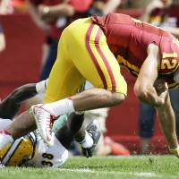 Photo - Iowa State quarterback Sam B. Richardson (12) is sacked by North Dakota State linebacker Carlton Littlejohn (38) during the second half of an NCAA college football game, Saturday, Aug. 30, 2014, in Ames, Iowa. North Dakota State won 34-14. (AP Photo/Charlie Neibergall)