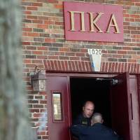 Photo - In this Nov. 2, 2012 photo, DeKalb police Sgt. Jason Leverton speaks with an Northern Illinois University police officer in the doorway of the Pi Kappa Alpha house in DeKalb, Ill. where police were investigating the death of NIU freshman David Bogenberger. Nearly two dozen Pi Kappa Alpha members at Northern Illinois University have been charged with hazing-related counts after Bogenberger was found dead at their fraternity house following a night of drinking. (AP Photo/Daily Chronicle, Kyle Bursaw) CHICAGO LOCALS OUT; ROCKFORD REGISTER STAR OUT; MANDATORY CREDIT