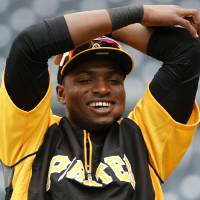 Photo - Pittsburgh Pirates' Gregory Polanco stretches during warm ups before a baseball game against the Chicago Cubs in Pittsburgh Tuesday, June 10, 2014. It will be Polanco's Major League debut. (AP Photo/Gene J. Puskar)