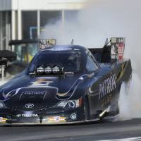 Photo - In this photo provided by the NHRA, Alexis DeJoria does a burnout during Funny Car qualifying for the NHRA Southern Nationals drag races at Atlanta Dragway on Friday, May 16, 2014, in Commerce, Ga. DeJoria took the top spot on the first day of qualifying. (AP Photo/NHRA, Marc Gewertz)