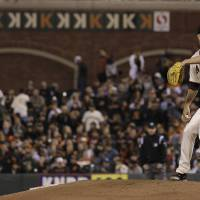 Photo -   San Francisco Giants pitcher Matt Cain delivers against the Houston Astros during the seventh inning of a baseball game in San Francisco, Wednesday, June 13, 2012. (AP Photo/Jeff Chiu)