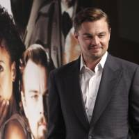 Photo - In this Saturday, March 2, 2013 photo, actor Leonardo DiCaprio poses for a photo call during a press conference to promote his new film