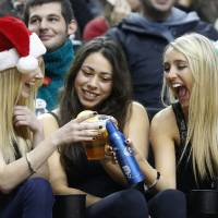 Photo - Three fans celebrate during the first quarter of an NBA basketball game between the Portland Trail Blazers and Phoenix Suns in Portland, Ore., Saturday, Dec. 22, 2012. (AP Photo/Don Ryan)