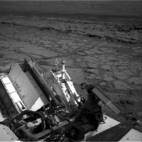 Photo - FILE - This Dec. 12, 2012 file image provided by NASA shows the Mars rover Curiosity at a pit stop, a shallow depression called