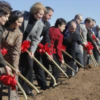 Photo - Above: Chickasaw Nation officials and other dignitaries participate in a groundbreaking Thursday for a medical clinic to be built adjacent to the Riverwind Casino.