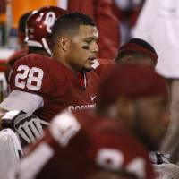 Photo - Oklahoma's Travis Lewis (28) sits on the bench during the college football game between the University of Oklahoma Sooners (OU) and the Texas Tech University Red Raiders (TTU) at Gaylord Family-Oklahoma Memorial Stadium in Norman, Okla., Sunday, Oct. 23, 2011. Oklahoma lost 38-41. Photo by Bryan Terry, The Oklahoman