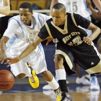 Photo - Kyndall Dudley (3), left, of Putnam City West and Greg Austin (23) of Midwest City chase a loose ball during the Class 6A boys high school basketball state tournament semifinal game between Midwest City and Putnam City West at the ORU Mabee Center in Tulsa, Okla., Friday, March 12, 2010. Midwest City won, 50-47. Photo by Nate Billings, The Oklahoman