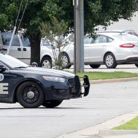 Photo - Oklahoma City police block off S. Blackwelder Ave. in front of Goodwill Industries, at 316 S Blackwelder Ave., after evacuating the building due to a bomb scare over two grenades found there in Oklahoma City Thursday, June 26, 2014.  Photo by Paul B. Southerland, The Oklahoman