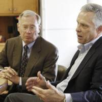 Photo - Phil Horning, left and Kirk Humphreys discuss their negotiations to create a unique charter school in downtown Oklahoma City managed by a public-private partnership. Photo by Steve Gooch  Steve Gooch