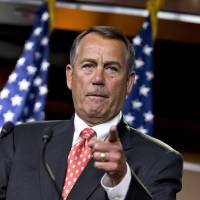 Photo - House Speaker John Boehner of Ohio gestures as he speaks to reporters on Capitol Hill in Washington, Thursday, Nov. 29, 2012, after private talks with Treasury Secretary Timothy Geithner on the fiscal cliff negotiations. Boehner said no substantive progress has been made between the White House and the House