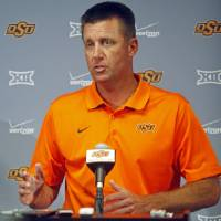 Photo -  Oklahoma State head coach Mike Gundy speaks at Oklahoma State University's media day at Gallagher-Iba Arena in Stillwater. Photo by K.T. King, The Oklahoman   KT King -