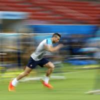 Photo - In this photograph taken with a slow shutter, Portugal's Cristiano Ronaldo works out during a training session at the Arena da Amazonia in Manaus, Brazil, Sunday, June 22, 2014. Portugal will play against the United States in group G of the 2014 soccer World Cup on June 22. (AP Photo/Julio Cortez)