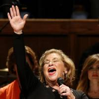 Photo -  Gospel recording artist Sandi Patty sings during the Church of God Convention on Tuesday at Crossings Community Church, 14600 N Portland in Oklahoma City. Photo by Bryan Terry, The Oklahoman   BRYAN TERRY