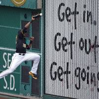 Photo - Pittsburgh Pirates right fielder Gregory Polanco (25) can't get to a double off the right field wall by Cincinnati Reds' Joey Votto during the fourth inning of a baseball game in Pittsburgh Thursday, June 19, 2014. (AP Photo/Gene J. Puskar)