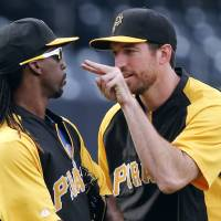 Photo - Pittsburgh Pirates' Ike Davis, right, lets Andrew McCutchen knows he is jokingly watching him before a baseball game against the San Diego Padres, Monday, June 2, 2014, in San Diego. (AP Photo/Lenny Ignelzi)