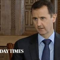 Photo - In this image taken from video filmed on Thursday, Feb. 28, 2013 and released Saturday evening, March 2, 2013, Syrian President Bashar Assad speaks during an interview with the Sunday Times, in Damascus, Syria. Iran and Syria condemned a U.S. plan to assist rebels fighting to topple Assad on Saturday and signaled the Syrian leader intends to stay in power at least until 2014 presidential elections. Assad told the Sunday Times in the interview timed to coincide with U.S. Secretary of State John Kerry's first foreign trip that