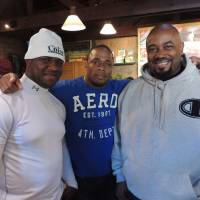 Photo - From left, Jamaican bobsled team members Wayne Blackwood, Marvin Dixon and coach Wayne Thomas pose at the MorningStar Veggie Burger Bar in Park City, Utah, on Monday, Jan. 20, 2014, as the team, bound for the Winter Olympics in Sochi, Russia, arrives at the Sundance Film Festival to raise funds for travel and equipment for their Olympic quest. (AP Photo/Nekesa Mumbi Moody)