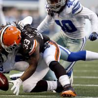 Photo -   Cleveland Browns running back Trent Richardson (33) loses control of the ball after being tackled by Dallas Cowboys' Gerald Sensabaugh (43) as Danny McCray (40) watches in the second half of an NFL football game, Sunday, Nov. 18, 2012, in Arlington, Texas. Richardson recovered his own fumble on the play. (AP Photo/Sharon Ellman)