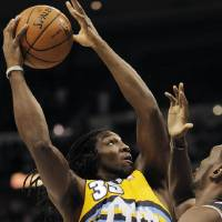 Photo -   Denver Nuggets small forward Kenneth Faried (35) drives to the basket as he runs into Utah Jazz center Al Jefferson (25) during the first quarter of an NBA basketball game, Friday, Nov. 9, 2012, in Denver. (AP Photo/Barry Gutierrez)