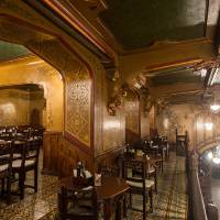 Photo - This photo taken Monday, July 31, 2014, shows the upper level of Caru cu Bere restaurant, in Bucharest, Romania. Caru cu Bere, a fabled restaurant in the Old City, has been serving cold beer, spicy sausages and a lot more since the last year of the 19th century. (AP Photo/Octav Ganea) ROMANIA OUT