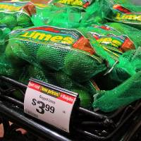 Photo -   Limes are seen on sale for $3.99 for a 1-pound bag at a Ralphs market in Los Angeles.    Reed Saxon -  AP