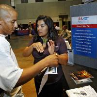 Photo - Claudia Phelps of McLane Advanced Technologies talks with Bryant Carr during the military job fair at the Coca-Cola Events Center on Thursday, July 31, 2008, in Oklahoma City, Okla.   Staff Photo By CHRIS LANDSBERGER ORG XMIT: KOD