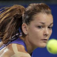 Photo -   Agnieszka Radwanska of Poland returns a shot to Angelique Kerber of Germany during their semifinal match at the Japan Pan Pacific Open tennis tournament in Tokyo, Friday, Sept. 28, 2012. Radwanska won 6-1, 6-1. (AP Photo/Itsuo Inouye)