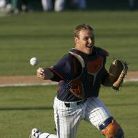 Photo - Pepperdine catcher Aaron Barnett throws out a runner at first after a bunt during the second inning of an NCAA college baseball tournament regional game on Sunday, June 1, 2014, at Baggett Stadium at Cal Poly in San Luis Obispo, Calif. (AP Photo/Aaron Lambert)