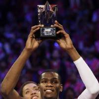 Photo - Oklahoma City Thunder sophomore guard Kevin Durant (35) holds the trophy after being named MVP of the All-Star Rookie Challenge NBA basketball game, Friday, Feb. 13, 2009, in Phoenix. (AP Photo/Ross D. Franklin) ORG XMIT: AZRH113