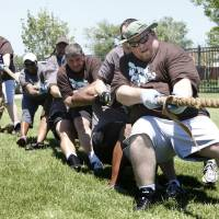 Photo - Jonathon Denton takes the lead position for American Fidelity in the tug-o-war event during the OU Medicine Corporate Challenge at Bishop McGuiness High School in Oklahoma City, OK, Saturday, June 5, 2010. By Paul Hellstern, The Oklahoman ORG XMIT: KOD