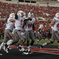 Photo - CELEBRATION: Oklahoma State's Josh Stewart (5) celebrates a Cowboys fumble recovery on a kickoff during a college  football game between Texas Tech University (TTU) and Oklahoma State University (OSU) at Jones AT&T Stadium in Lubbock, Texas, Saturday, Nov. 12, 2011.  Photo by Sarah Phipps, The Oklahoman  ORG XMIT: KOD
