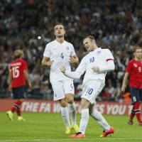 Photo - England's Wayne Rooney celebrates after scoring the opening goal during the international friendly soccer match between England and Norway at Wembley Stadium in London, Wednesday, Sept. 3, 2014. (AP Photo/Alastair Grant)