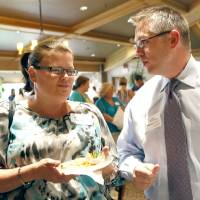 Photo - Michelle Young and Jason Galloway talk during a new teachers reception sponsored by the Edmond Area Chamber of Commerce. PHOTO BY SARAH PHIPPS, THE OKLAHOMAN.  SARAH PHIPPS - THE OKLAHOMAN