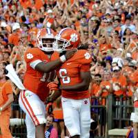 Photo -   Clemson quarterback Tajh Boyd (10) celebrates DeAndre Hopkins' second-quarter touchdown reception during an NCAA college football game against Georgia Tech on Saturday, Oct. 6, 2012, at Memorial Stadium in Clemson, S.C. (AP Photo/ Richard Shiro)