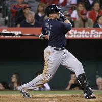 Photo - CORRECTS NUMBER OF RBIS TO THREE - SEattle Mariners' Justin Smoak hits a three-RBI double against the Los Angeles Angels during the third inning of a baseball game on Tuesday, April 1, 2014, in Anaheim, Calif. (AP Photo/Jae C. Hong)
