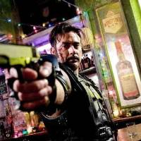 Photo - In this movie still released by Warner Bros., Jeffrey Dean Morgan stars as The Comedian in a scene from the film,