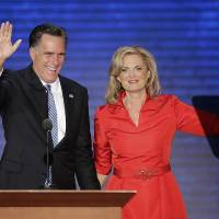 Photo -   Ann Romney is greeted on stage by her husband Republican presidential nominee Mitt Romney after her speech to the Republican National Convention in Tampa, Fla. on Tuesday, Aug. 28, 2012. (AP Photo/J. Scott Applwhite)