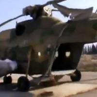 Photo - In this image taken from video obtained from the Ugarit News, which has been authenticated based on its contents and other AP reporting, Free Syrian Army fighters capture a helicopter at the Marj al-Sultan military air base in Damascus, Syria, on Wednesday, Nov. 28, 2012. (AP Photo/Ugarit News via AP video)