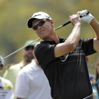 Photo - John Senden, of Australia, tees off on the second hole during the final round of the Valspar Championship golf tournament at Innisbrook, Sunday, March 16, 2014, in Palm Harbor, Fla. (AP Photo/Chris O'Meara)