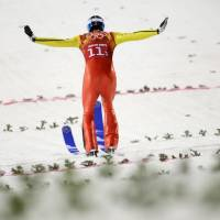 Photo - Germany's Andreas Wank lands his second attempt during the ski jumping large hill team competition at the 2014 Winter Olympics, Monday, Feb. 17, 2014, in Krasnaya Polyana, Russia. (AP Photo/Gregorio Borgia)