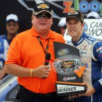 Photo - Driver Brad Keselowski, right, accepts the trophy from Dr. Jeff Jarvis after winning the NASCAR UNOH 200 Truck Series auto race on Thursday, Aug. 21, 2014, in Bristol, Tenn. (AP Photo/Wade Payne)