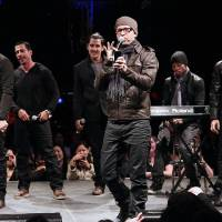 Photo - In this picture provided by Starpix, New Kids on the Block members, from left, Jordan Knight, Danny Wood, Jonathan Knight, Donnie Wahlberg, and Joey McIntyre, far right, perform during the announcement of