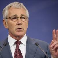 Photo - U.S. Defense Secretary Chuck Hagel speaks during his news conference at the conclusion of a meeting of the North Atlantic Council (NATO) in Brussels, Wednesday, June 4, 2014. NATO defense ministers gathered for the first time since the Ukraine crisis, and top of the agenda was how to react long-term to Russia's new military capabilities and its willingness to use them. (AP Photo/Pablo Martinez Monsivais, Pool)