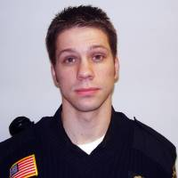 Photo - This photo provided by the Minnesota Department of Public Safety shows Cold Spring, Minn., police officer Tom Decker who was shot twice and died Thursday, Nov. 29, 2012 in what authorities are calling an ambush killing. Officials says Decker was responding to a call from a concerned family member about a man in Cold Spring, Minn., who might be suicidal. Thirty-four-year-old Ryan Michael Larson of Cold Spring was arrested at the scene and prosecutors are reviewing the case for charges.  (AP Photo/Stearns County Sheriff)