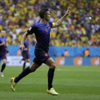 Photo - Netherlands' Robin van Persie celebrates after scoring his team's first goal on a penalty shot during the World Cup third-place soccer match between Brazil and the Netherlands at the Estadio Nacional in Brasilia, Brazil, Saturday, July 12, 2014. (AP Photo/Natacha Pisarenko)