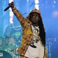 Photo - FILE - In this March 1, 2012 file photo, Lil Wayne performs at the Caesars Entertainment