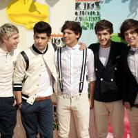 "Photo -   FILE - In this March 31, 2012 file photo, One Direction, from left, Niall Horan, Zayn Malik, Louis Tomlinson, Liam Payne, and Harry Styles arrive at Nickelodeon's 25th Annual Kids' Choice Awards in Los Angeles. On Nov. 13, 2012, One Direction released its sophomore album, ""Take Me Home,"" which comes eight months after the boy band dropped its debut, ""Up All Night,"" which debuted at No. 1 and is platinum. (AP Photo/Chris Pizzello File)"