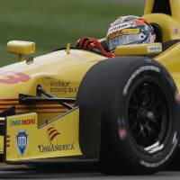 Photo - Ryan Hunter-Reay drives through a turn during qualifications for the inaugural Grand Prix of Indianapolis IndyCar auto race at the Indianapolis Motor Speedway in Indianapolis, Friday, May 9, 2014. (AP Photo/Darron Cummings)