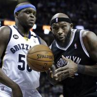 Photo - Brooklyn Nets' Reggie Evans, right, is pressured by Memphis Grizzlies' Zach Randolph (50) during the first half of an NBA basketball game in Memphis, Tenn., Friday, Jan. 25, 2013. (AP Photo/Danny Johnston)