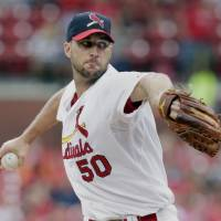Photo - St. Louis Cardinals starting pitcher Adam Wainwright (50) sets to deliver a pitch in the first inning of a baseball game against the San Diego Padres, Sunday, Aug. 17, 2014, in St. Louis. (AP Photo/Tom Gannam)